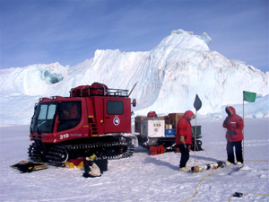 Antarctic researchers with PistenBully and submersible research vehicles